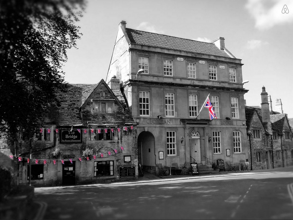 A black and white image of the outside of the Georgian Lodge.